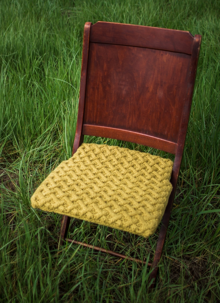 Organic cable knit basket stitch chair.