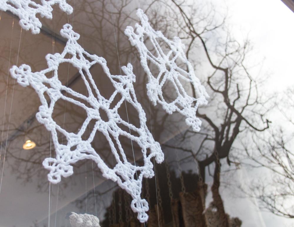 crochet snowflakes window display