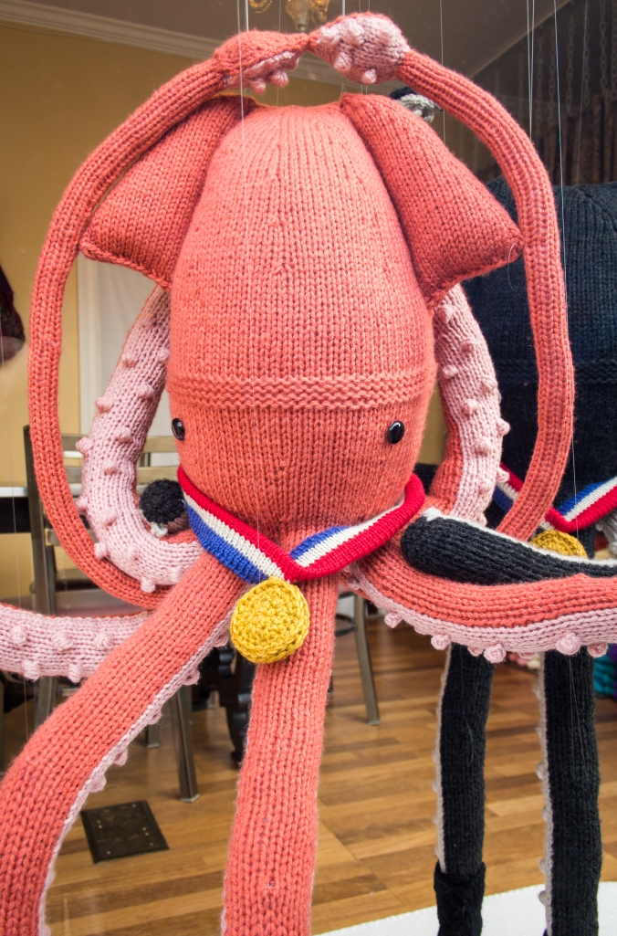 ice dancing squid knit window display