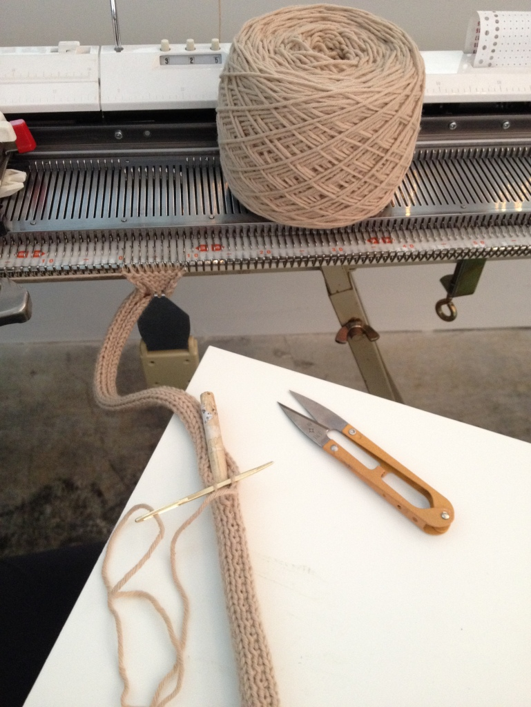 Machine knitting a wooden dowel