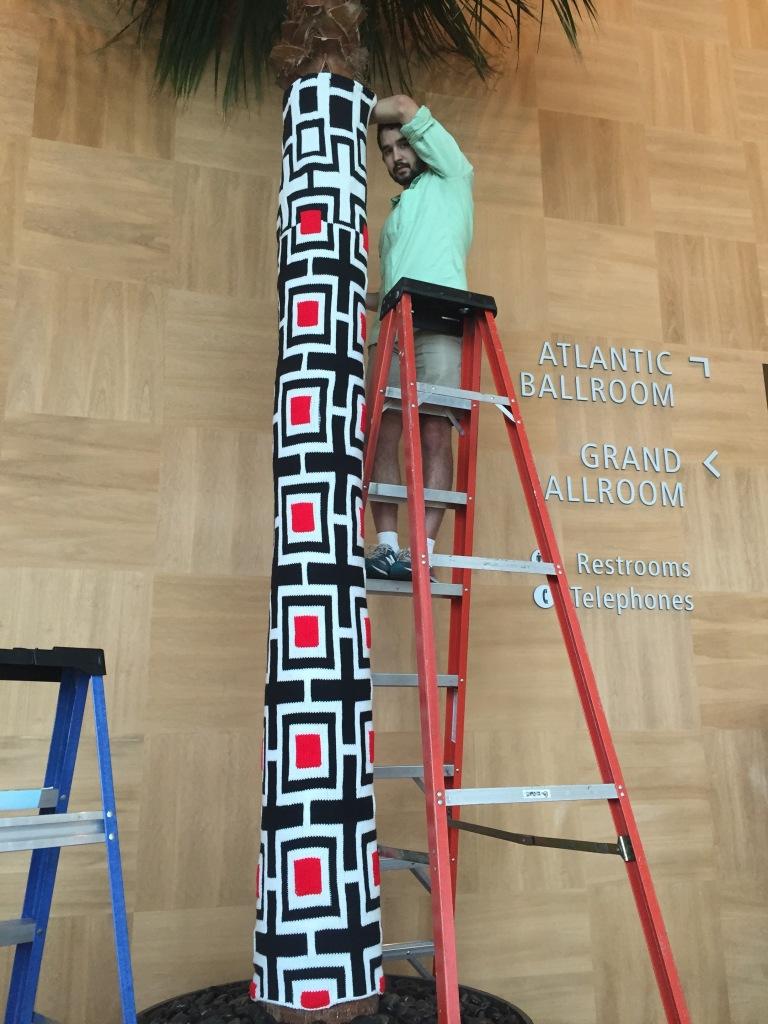 Positivitrees yarn installation Merck IDesign Mondo Guerra Knits for Life Lorna Watt Jill Watt yarn bomb