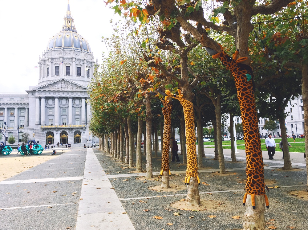 Knitting the Commons San Francisco Giraffe Yarn bomb by Knits for Life