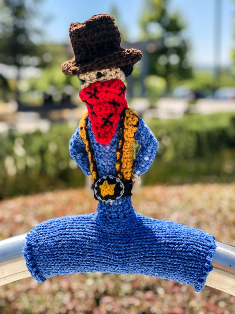 Cowboy bike rack yarn bomb by Knits for Life