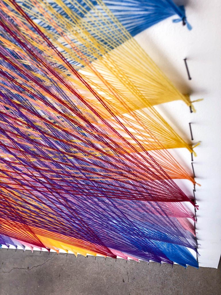 String art murals by Knits for Life